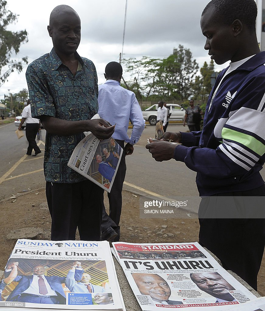 A newspaper vendor sells local newspapers on March 31, 2013 in Nairobi with the headline of Kenyan fourth president Uhuru Kenyatta's win, following the supreme court's decision that he was duly elected. Kenyan police beefed up security today after a court decision upholding Uhuru Kenyatta's presidential vote win drew his rival's supporters into the streets, sparking riots that left two dead. Raila Odinga had challenged the result of the March 4 poll hoping for a rerun but while he begrudgingly accepted the Supreme Court's decision on Saturday, youths in his strongholds were enraged.