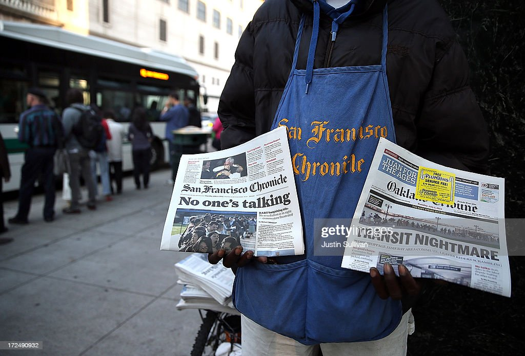 A newspaper vendor sells papers as commuters wait in line to board an AC Transit on July 2, 2013 in Oakland, California. For a second day, hundreds of thousands of San Francisco Bay Area commuters are scrambling to find ways to work after two of San Francisco Bay Area Rapid Transit's (BART) largest unions went on strike early yesterday morning following contract negotiations with management falling apart the day before. Train operators, mechanics, station agents and maintenance workers are seeking a five percent wage increase and are fighting management who want to have workers to begin contributing to their pensions, pay more for health insurance and reduce overtime expenses.