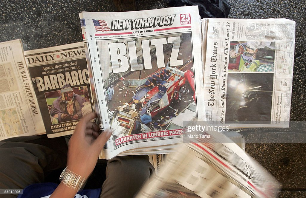 A newspaper vendor sorts issues with headlines about the London terror attacks while riding the subway during the morning rush hour July 8, 2005 in New York City. Security on subway trains and buses was increased in the wake of explosions that killed at least 50 people and injured many others on London's mass transit system July 7, 2005.