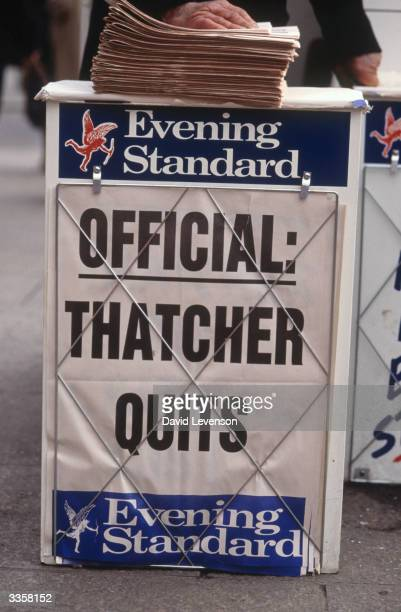 A newspaper vendor's stand in London showing the headline of the London Evening Standard announcing the resignation of Maragaret Thatcher as Prime...