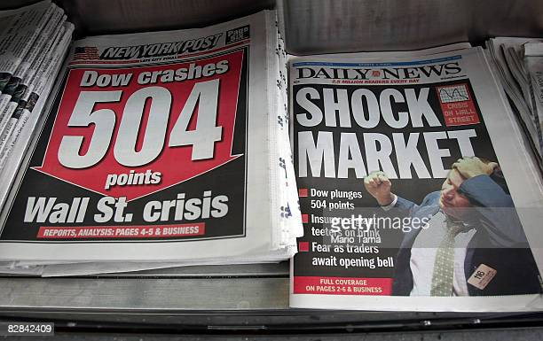 Newspapers are seen for sale at a newsstand September 16 2008 in New York City US stocks were mixed following yesterday's Dow Jones Industrial...