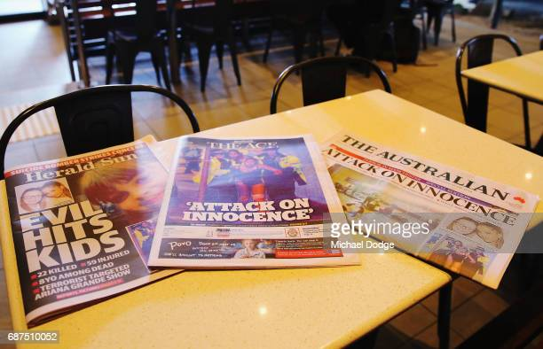 Newspapers are seen with headlines and stories covering the Manchester Bombing on May 24 2017 in Melbourne Australia An explosion occurred at...