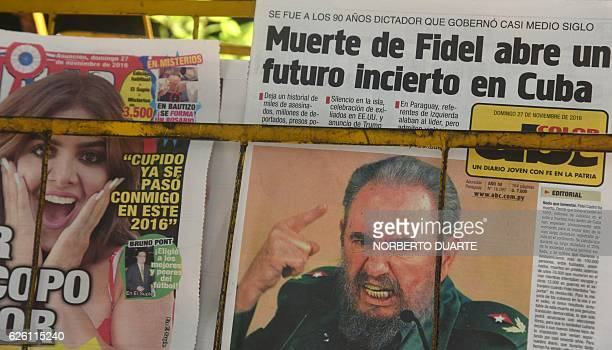 Newspapers depicting Cuba's historic revolutionary leader Fidel Castro are sold in Asuncion on November 27 2016 just two days after Castro's death...