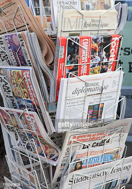 Newspapers for sale in rack, close up
