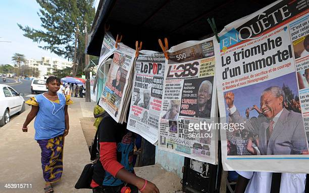 Newspapers front pages bearing portraits of late President Nelson Mandela are displayed at a newsstand in Dakar Senegal on December 6 2013 Very few...