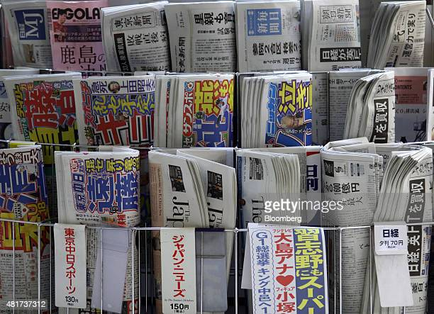 Newspapers including the Nikkei bottom right are displayed for sale in Tokyo Japan on Friday July 24 2015 After almost six decades of stewardship of...