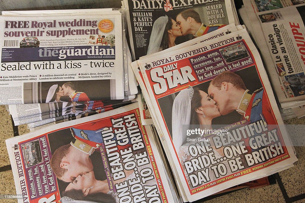 Newspapers lying at a newsstand show their Royal Highnesses Prince William, Duke of Cambridge and Catherine, Duchess of Cambridge kissing following their wedding the day before on April 30, 2011 in London, England. The marriage of the second in line to the British throne was led by the Archbishop of Canterbury and was attended by 1900 guests, including foreign Royal family members and heads of state. Thousands of well-wishers from around the world flocked to London to witness the spectacle and pageantry of the Royal Wedding.