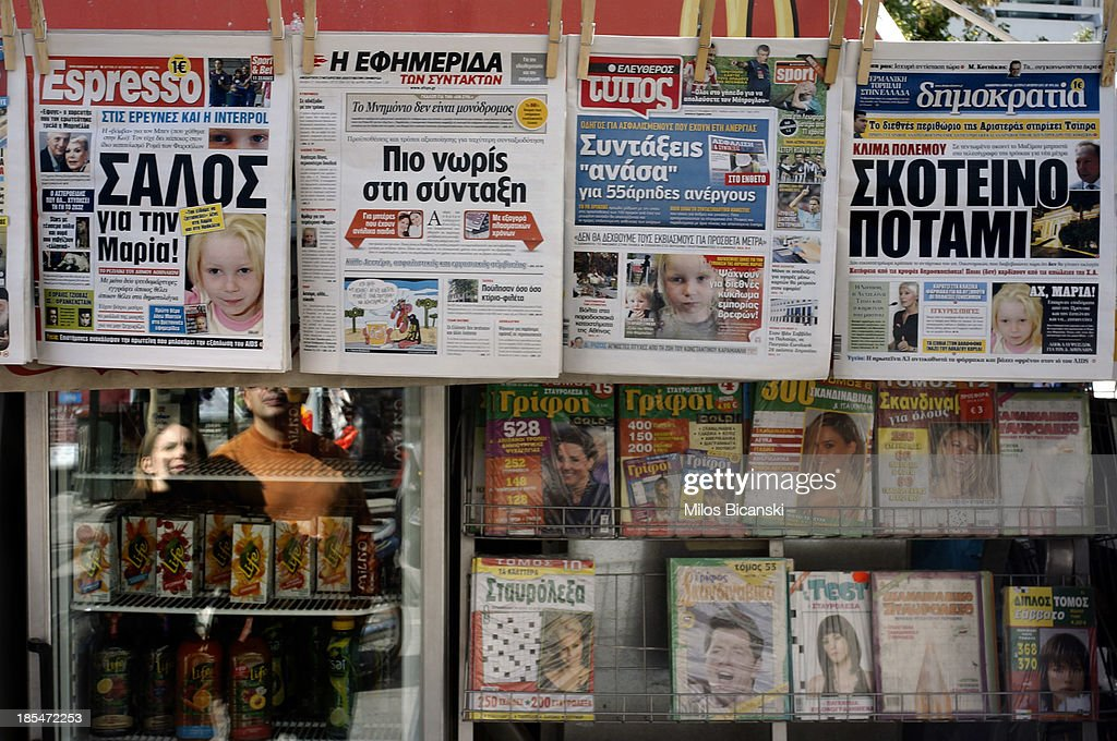 Newspapers on a stand which feature front pages reporting on the story a four-year-old girl reportedly named Maria, who was found living with a Roma couple in central Greece, on October 21, 2013 in Athens, Greece. The Roma couple are due to appear in court today in Larissa, Greece, on charges of abducting the young girl, who was found on Wednesday October 16th, 2013, at a Roma settlement near Farsala in central during a police raid of the area for suspected drug trafficking.