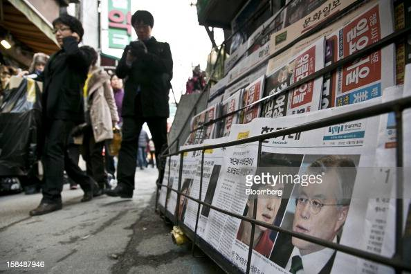 Newspapers reporting on South Korean presidential candidates Park Geun Hye from the ruling New Frontier Party left and Moon Jae In from the main...