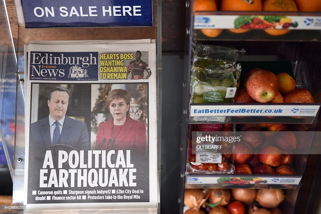 Newspapers reporting on the pro-Brexit result of the UK's EU referendum vote and with an image of British Prime Minister David Cameron and Scotland's First Minister and Leader of the Scottish National Party (SNP), Nicola Sturgeon, are pictured in a store in Edinburgh, Scotland on June 25, 2016. The result of Britain's June 23 referendum vote to leave the European Union (EU) has pitted parents against children, cities against rural areas, north against south and university graduates against those with fewer qualifications. London, Scotland and Northern Ireland voted to remain in the EU but Wales and large swathes of England, particularly former industrial hubs in the north with many disaffected workers, backed a Brexit. / AFP / OLI