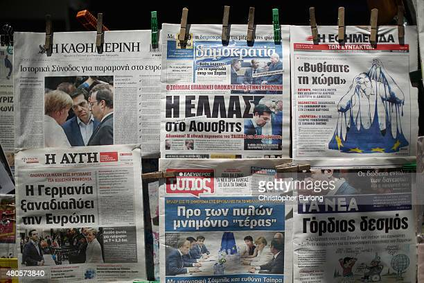 Newspapers reporting the Euro crisis are displayed outside a street vendor on July 13 2015 in Athens Greece Eurozone leaders have reportedly made an...