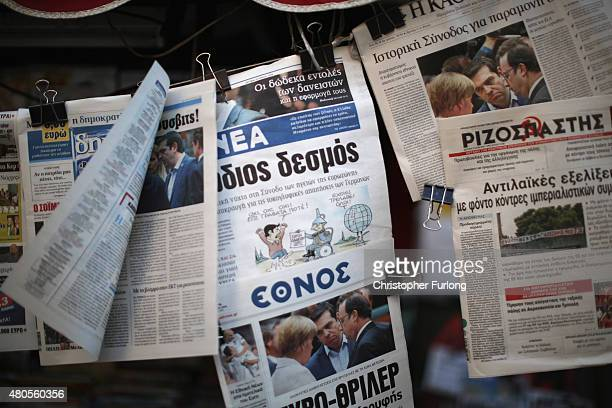 Newspapers reporting the euro crisis are displayed outside a vendors in downtown Athens on July 13 2015 in Athens Greece Eurozone leaders have...