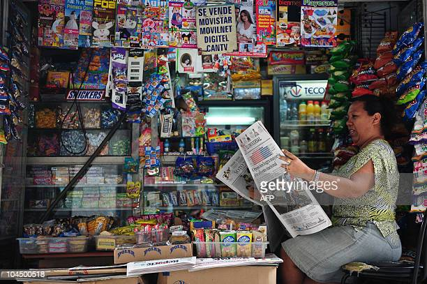 A newspapers vendor reads a newspaper whose frontpage refers to yesterday's legislative elections September 27 2010 Venezuela's leftist leader Hugo...