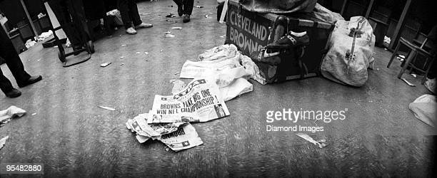 Newspapers with banner headlines on the floor of the lockerroom announce the Cleveland Browns as the champions of the National Football League after...