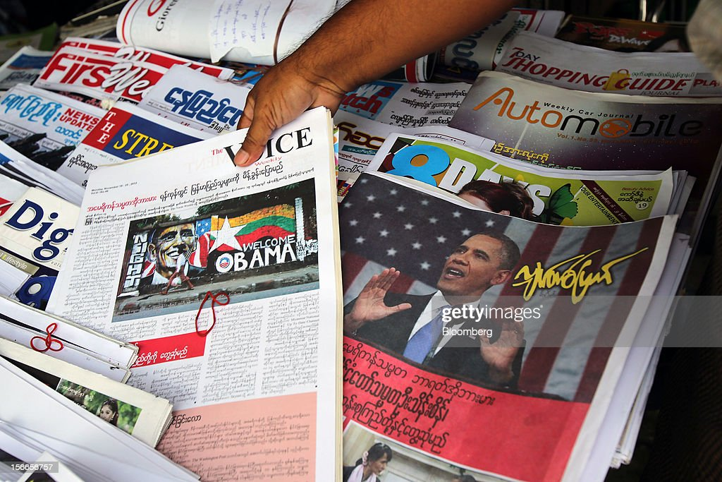 Newspapers with images of U.S. President <a gi-track='captionPersonalityLinkClicked' href=/galleries/search?phrase=Barack+Obama&family=editorial&specificpeople=203260 ng-click='$event.stopPropagation()'>Barack Obama</a> are displayed in Yangon, Myanmar, on Sunday, Nov. 18, 2012. President <a gi-track='captionPersonalityLinkClicked' href=/galleries/search?phrase=Barack+Obama&family=editorial&specificpeople=203260 ng-click='$event.stopPropagation()'>Barack Obama</a> will become the first sitting U.S. president to visit Myanmar when he travels to Yangon on Nov. 19 to meet President Thein Sein and Aung San Suu Kyi, the opposition leader who spent more than 15 years under house arrest before the country shifted to democracy after decades of military rule. Photographer: Dario Pignatelli/Bloomberg via Getty Images
