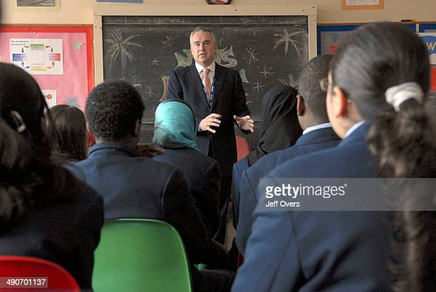 BBC newsreader and presenter Huw Edwards talks to schoolchildren on a visit to the Paddington Academy a secondary school in Paddington London...