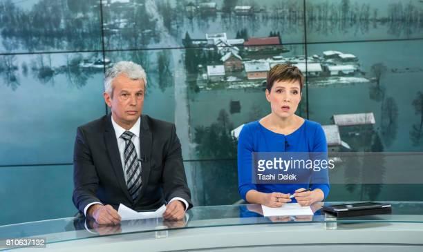 Newsreader Couple In Television Studio