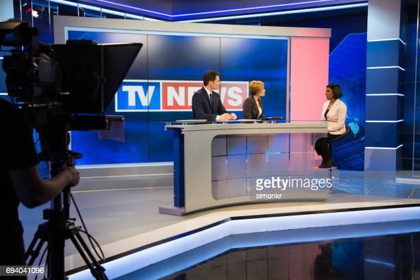 Newsreader filming in press room