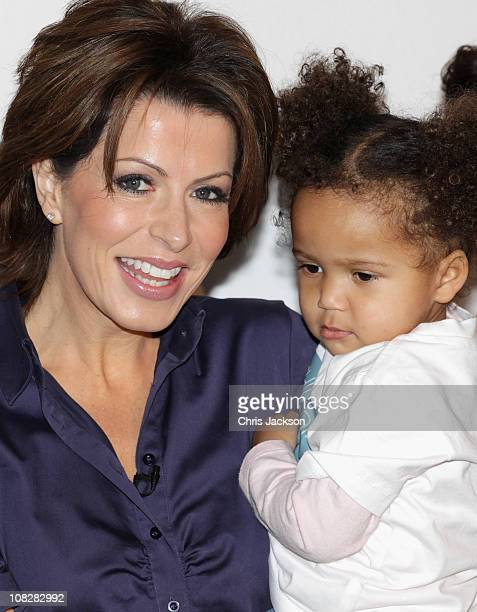 Newsreader Natasha Kaplinsky holds 2 and a 1/2 year old Iris during a photocall for the Save the Children 'No Child Born to Die' Campaign launch at...