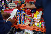 A newsstand owner right checks his invoice from his weekly order of Grupo Bimbo SAB snacks in Mexico City Mexico on Thursday July 21 2016 Grupo Bimbo...