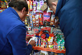 A newsstand owner right checks his invoice from his weekly order of Grupo Bimbo SAB snacks with the deliveryman in Mexico City Mexico on Thursday...