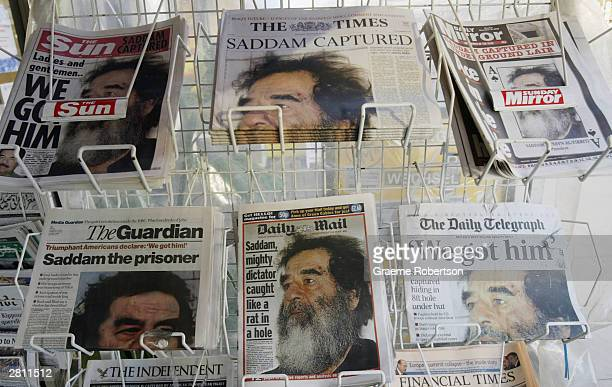 A newsstand sells papers whose front pages report the capture of former Iraqi leader Saddam Hussein December 15 2003 in London US forces captured...