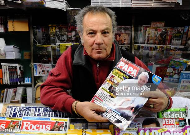 A newsstand vendor holds the new Italian magazine Il Mio Papa published by Mondadori in Rome on March 7 2014 A magazine entitled 'My Pope' billed as...