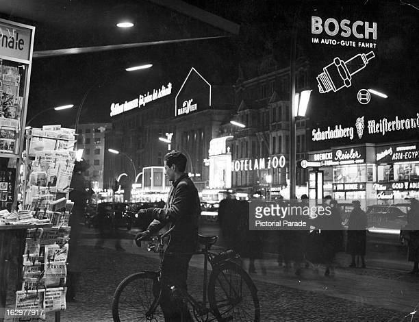 Newstand in West Berlin's Kurfuerstendamm during night time 1955