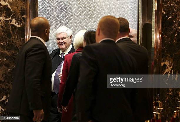 Newt Gingrich former speaker of the US House of Representatives center stands in an elevator after arriving at Trump Tower in New York US on Monday...