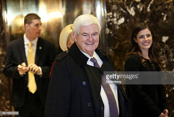 Newt Gingrich former speaker of the US House of Representatives center smile while arriving at Trump Tower in New York US on Monday Nov 21 2016...