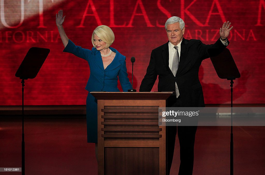 <a gi-track='captionPersonalityLinkClicked' href=/galleries/search?phrase=Newt+Gingrich&family=editorial&specificpeople=202915 ng-click='$event.stopPropagation()'>Newt Gingrich</a>, former U.S. Speaker of the House, right, and wife <a gi-track='captionPersonalityLinkClicked' href=/galleries/search?phrase=Callista+Gingrich&family=editorial&specificpeople=4374496 ng-click='$event.stopPropagation()'>Callista Gingrich</a> wave before speaking at the Republican National Convention (RNC) in Tampa, Florida, U.S., on Thursday, Aug. 30, 2012. Republican presidential nominee Mitt Romney, a wealthy former business executive who served as Massachusetts governor and as a bishop in the Mormon church, is under pressure to show undecided voters more personality and emotion in his convention speech tonight, even as fiscal conservatives in his own party say he must more clearly define his plans for reining in the deficit and improving the economy. Photographer: Scott Eells/Bloomberg via Getty Images