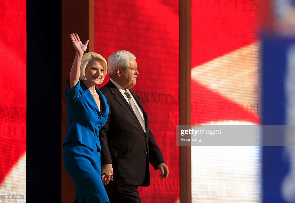 <a gi-track='captionPersonalityLinkClicked' href=/galleries/search?phrase=Newt+Gingrich&family=editorial&specificpeople=202915 ng-click='$event.stopPropagation()'>Newt Gingrich</a>, former U.S. Speaker of the House, right, and wife <a gi-track='captionPersonalityLinkClicked' href=/galleries/search?phrase=Callista+Gingrich&family=editorial&specificpeople=4374496 ng-click='$event.stopPropagation()'>Callista Gingrich</a> gesture on stage before speaking at the Republican National Convention (RNC) in Tampa, Florida, U.S., on Thursday, Aug. 30, 2012. Republican presidential nominee Mitt Romney, a wealthy former business executive who served as Massachusetts governor and as a bishop in the Mormon church, is under pressure to show undecided voters more personality and emotion in his convention speech tonight, even as fiscal conservatives in his own party say he must more clearly define his plans for reining in the deficit and improving the economy. Photographer: Andrew Harrer/Bloomberg via Getty Images