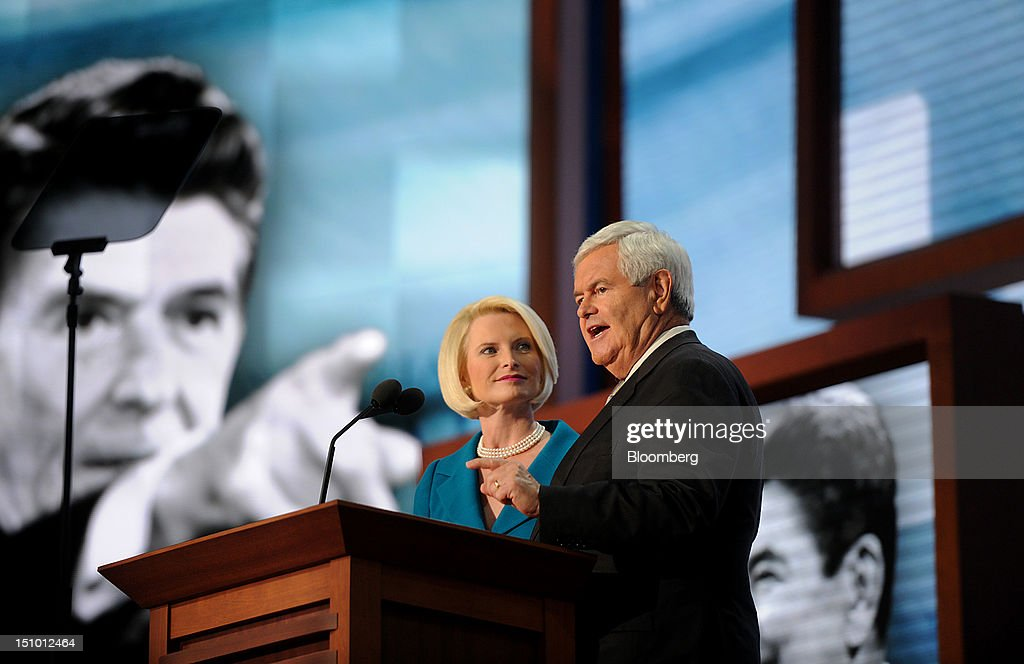 Newt Gingrich, former U.S. Speaker of the House, right, speaks while wife Callista Gingrich listens at the Republican National Convention (RNC) in Tampa, Florida, U.S., on Thursday, Aug. 30, 2012. Republican presidential nominee Mitt Romney, a wealthy former business executive who served as Massachusetts governor and as a bishop in the Mormon church, is under pressure to show undecided voters more personality and emotion in his convention speech tonight, even as fiscal conservatives in his own party say he must more clearly define his plans for reining in the deficit and improving the economy. Photographer: Daniel Acker/Bloomberg via Getty Images