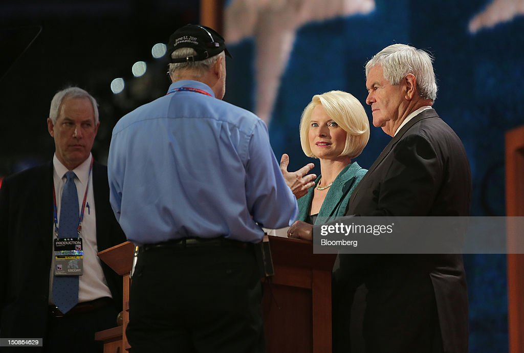 <a gi-track='captionPersonalityLinkClicked' href=/galleries/search?phrase=Newt+Gingrich&family=editorial&specificpeople=202915 ng-click='$event.stopPropagation()'>Newt Gingrich</a>, former U.S. Speaker of the House, right, with wife Callista Louise Gingrich, second right, prepares to speak tonight during a walk through at the Republican National Convention (RNC) in Tampa, Florida, U.S., on Tuesday, Aug. 28, 2012. Delegates are gathered in Tampa at the 40th Republican National Convention to select former Massachusetts governor Mitt Romney as their nominee for the next president of the United States. Photographer: Scott Eells/Bloomberg via Getty Images