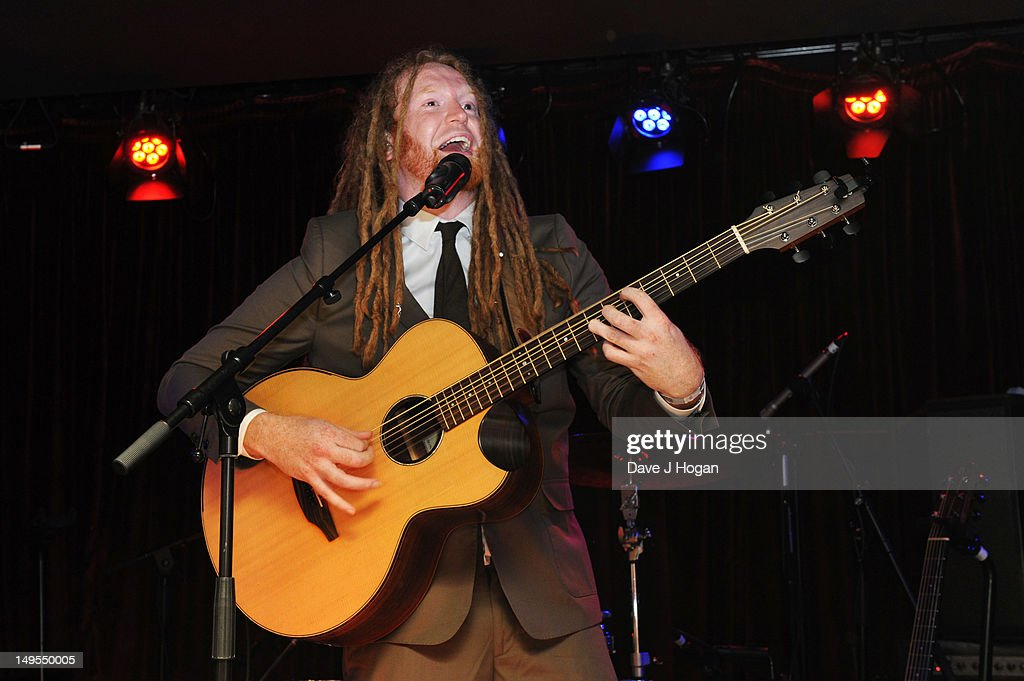 <a gi-track='captionPersonalityLinkClicked' href=/galleries/search?phrase=Newton+Faulkner&family=editorial&specificpeople=803617 ng-click='$event.stopPropagation()'>Newton Faulkner</a> performs at the UK Creatives Drinks Reception celebrating media, arts, sport and creativity in the UK at Dover Arts Club on July 30, 2012 in London, England.