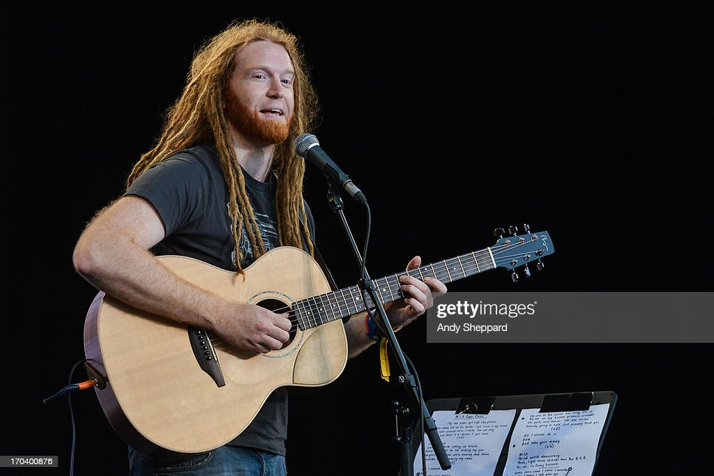 Newton Faulkner performs on stage in support of One campaign's Agit8 event at Tate Modern on June 12, 2013 in London, England.