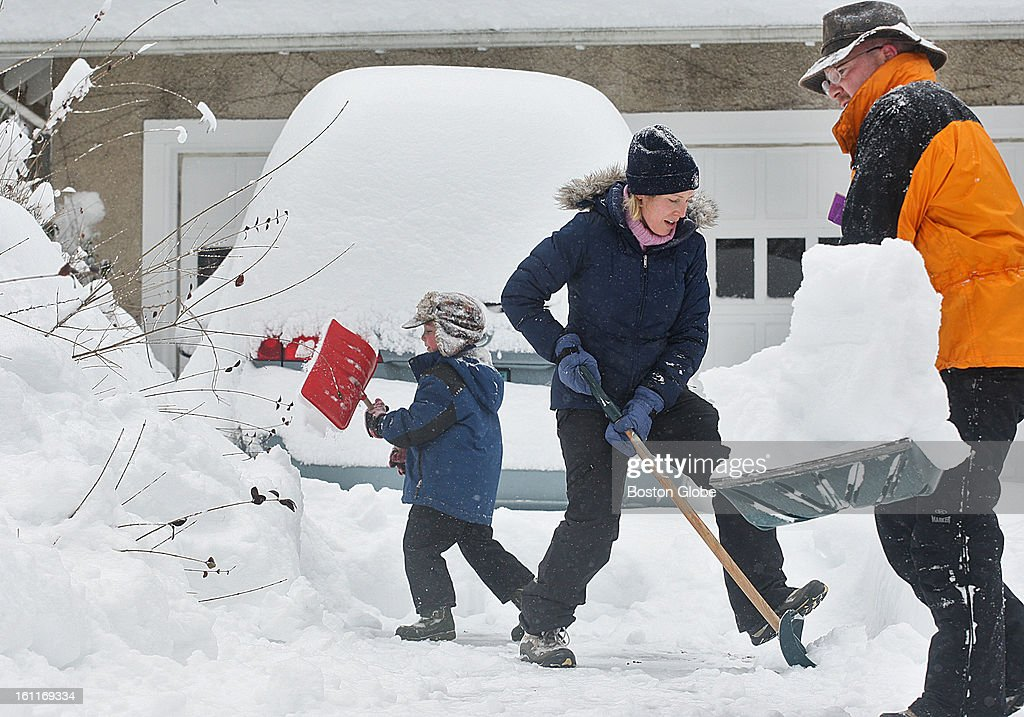 Newton residents struggle to dig out after the storm. The Gray family, Danny, 6, Jennifer, and Terry had to deal with a ton of snow to get their cars clear.