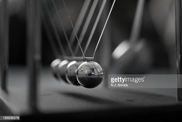 Newton's Cradle in Motion - Metallic Balls