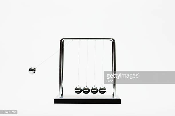 Newton's cradle swinging