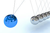 """High resolution render of Newton's Cradle, with a blue sphere, trying to interpret motion  and individuality and """"standing out from the crowd"""" concept."""
