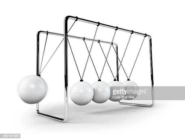 Newtons Cradle with golfballs swinging