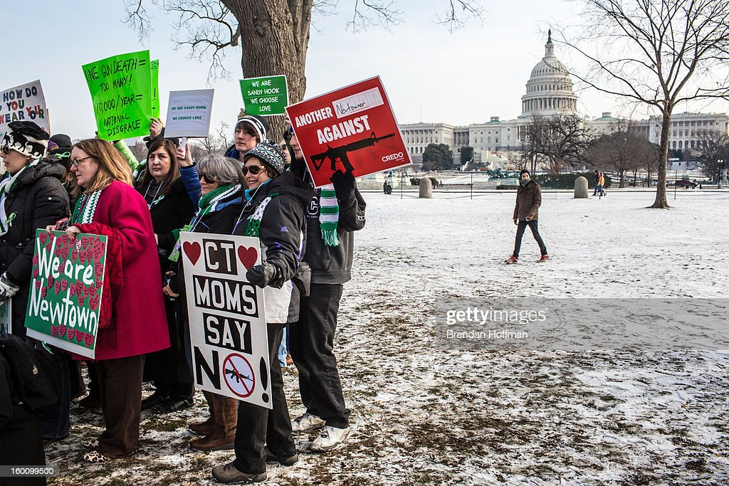 Newtown, Connecticut, families and residents gather near the U.S. Capitol for a march for stricter gun control laws on January 26, 2013 in Washington, DC. The demonstrators included survivors of the shooting at Virginia Tech, Newtown, Connecticut, and others.