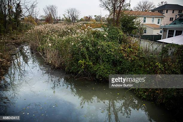 Newtown Creek flows past houses damaged two years ago by Superstorm Sandy on October 29 2014 in the Graham Beach neighborhood of the Staten Island...