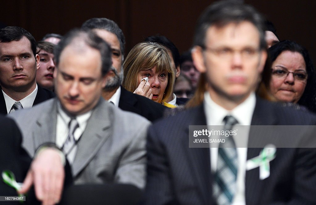 Newtown teachers, community members and parents of Sandy Hook Elementary School victims and survivors attend Senate Judiciary Committee hearing on 'The Assault Weapons Ban of 2013' at the Hart Senate Office Building in Washington, DC, on February 27, 2013. AFP PHOTO/Jewel Samad