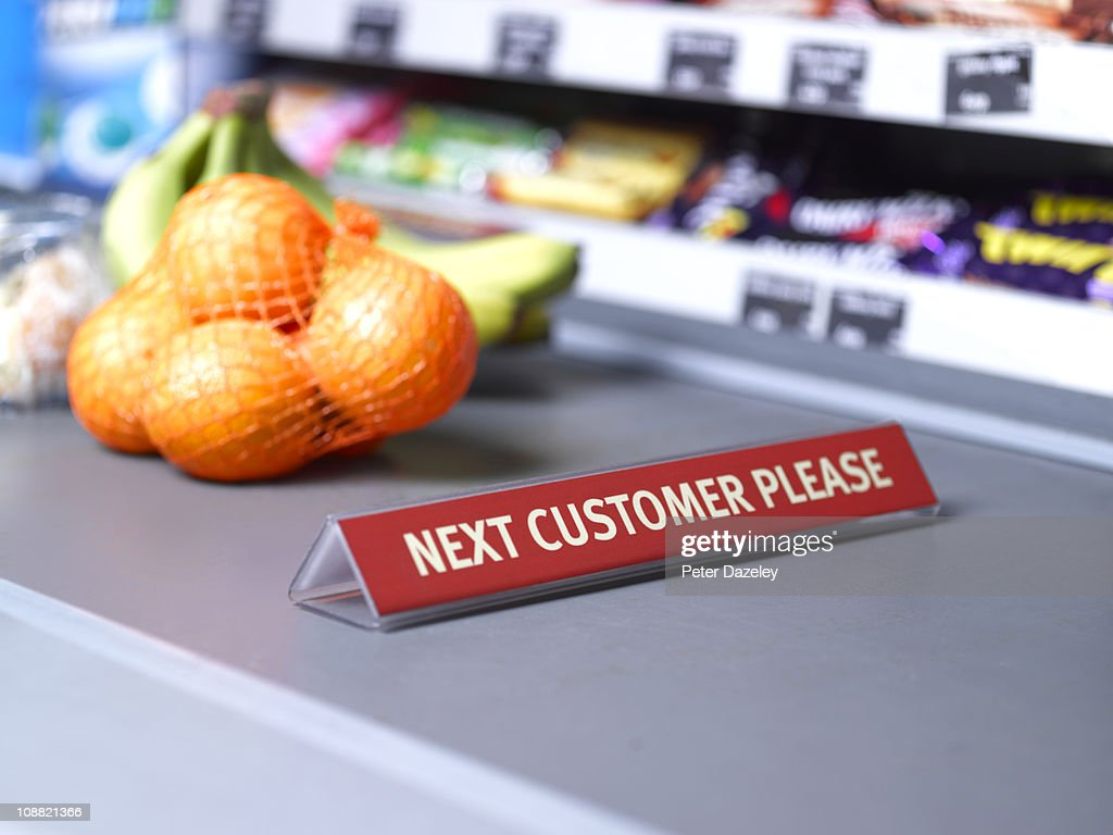 Next customer please sign on checkout : Stock Photo
