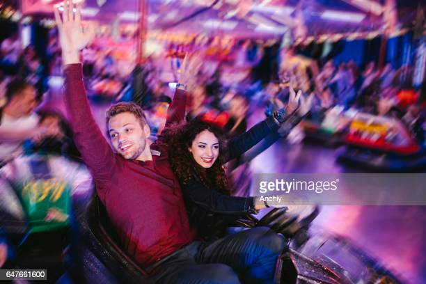 Next one is free, young couple won the bumper car ride