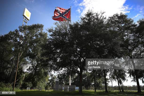 Next to Interstate 75 a Confederate Battle flag is seen as it flies above a monument erected in 2002 by the Florida Division of the Sons of...