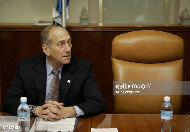 Next to the empty chair of Prime Minister Ariel Sharon Israeli acting Prime Minister Ehud Olmert take part in the weekly cabinet meeting in Jerusalem...