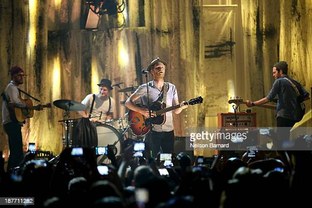 Neyla Pekarek Jeremiah Fraites and Wesley Schultz of The Lumineers perform on stage during the VH1 'You Oughta Know In Concert' 2013 on November 11...