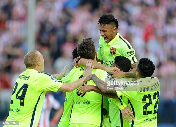 Neyman of FC Barcelona jumps on top of teammates after winning the La Liga at the end of the La Liga match between Club Atletico de Madrid and FC...